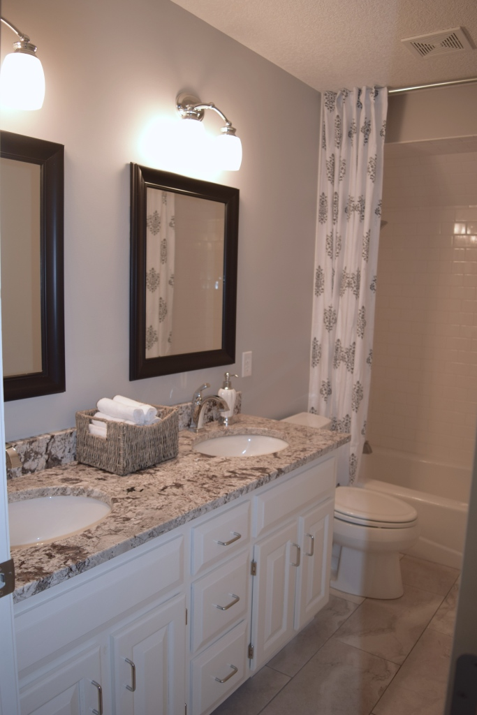 before after, bathroom, bathroom design, granite countertops, gray bathroom, katie kurtz, adorned homes, nkba, minnesota, north oaks mn, bathroom remodel, luxe living, interior design, decor, storage baskets, chrome faucet, delta, double vanity, double sink