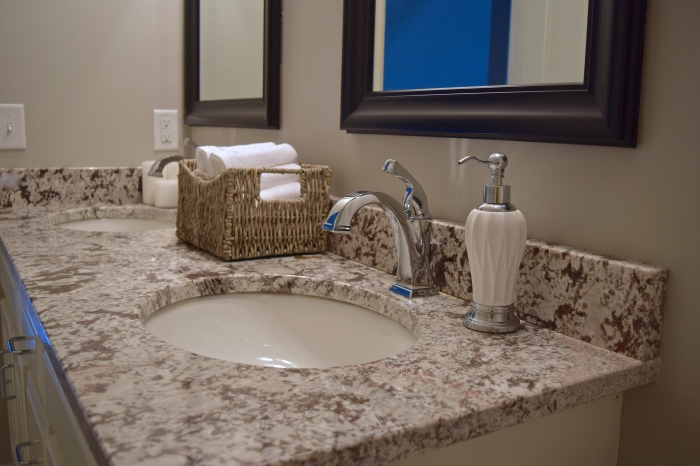 before after, bathroom, bathroom design, granite countertops, gray bathroom, katie kurtz, adorned homes, nkba, minnesota, north oaks mn, bathroom remodel, luxe living, interior design, decor, storage baskets, chrome faucet, delta